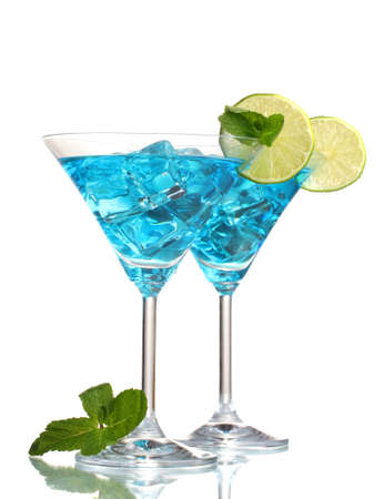 Blue cocktail in martini glasses with ice isolated on white photo