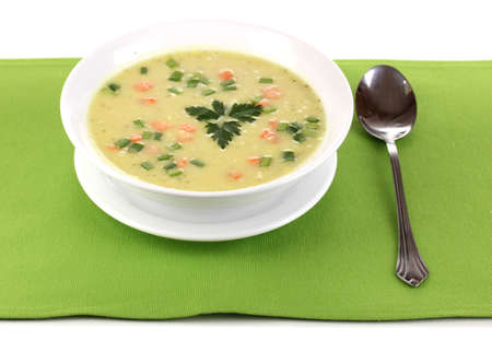 Tasty soup on green tablecloth isolated on white photo