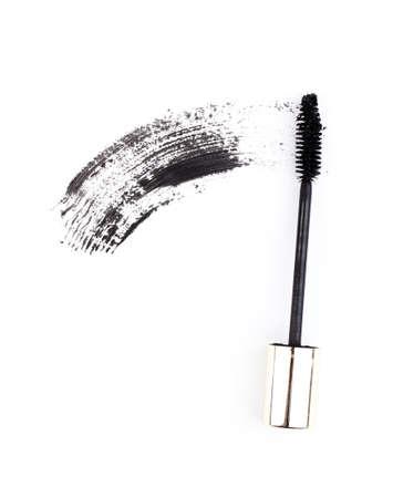 Black mascara brush stroke isolated on white photo