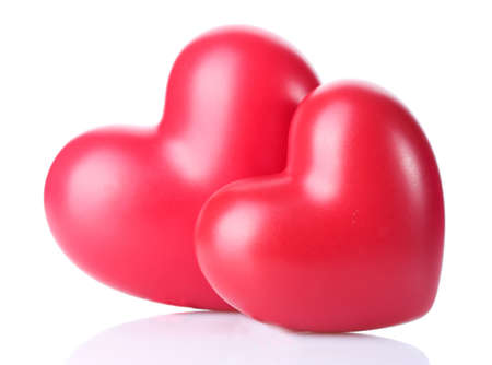two decorative red hearts isolated on white