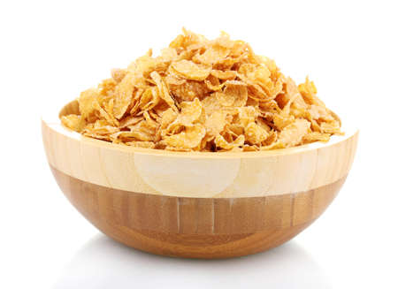 tasty cornflakes in wooden bowl isolated on white photo