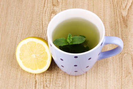 Mint tea with mint leaf and lemon on wooden background Stock Photo - 12548761