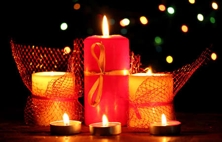 candlelight: Wonderful candles on wooden table on bright background Stock Photo