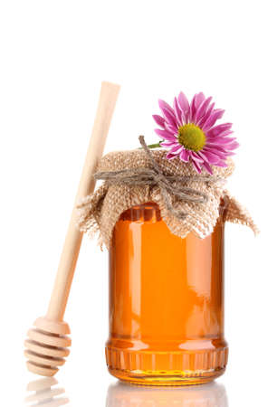 Sweet honey in jar with drizzler isolated on white Stock Photo - 12548673