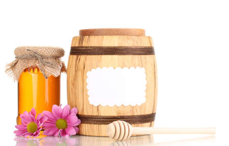 Sweet honey in jar and barrel with drizzler isolated on white photo