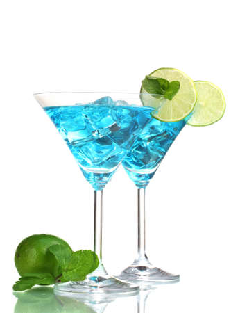 clubbing: Blue cocktail in martini glasses with ice isolated on white