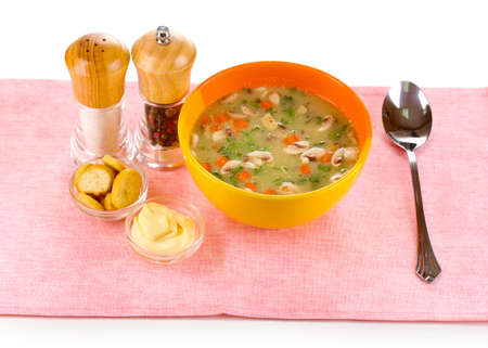 Tasty soup on pink tablecloth isolated on white Stock Photo - 12549586
