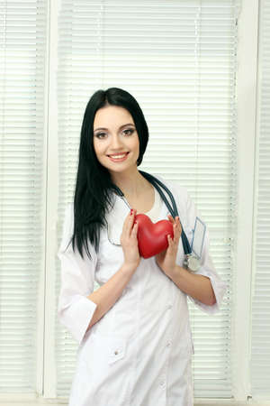 young beautiful doctor with stethoscope holding heart Stock Photo - 12566459
