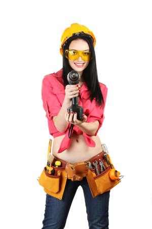 joven y bella chica de constructor de perforación celebración aislados en blanco Foto de archivo