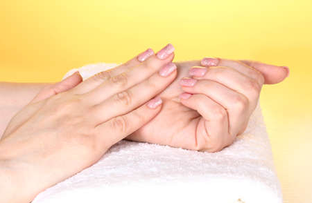 Female hands on towel Stock Photo - 12549763