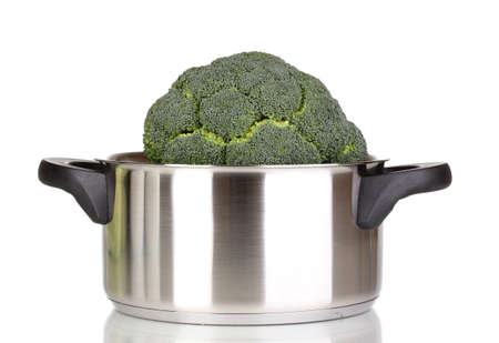 Fresh broccoli in saucepan isolated on white photo