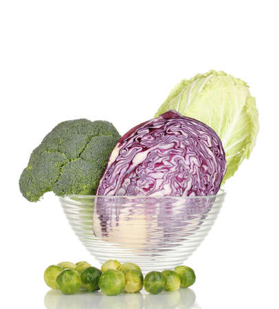 Glass bowl with cabbages and broccoli isolated on white photo