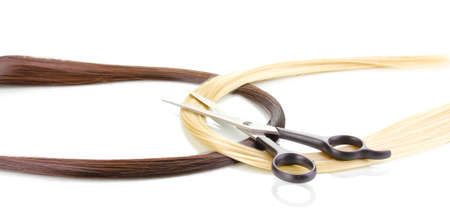 Shiny blond and brown hair with hair cutting shears isolated on white Stock Photo - 12553049