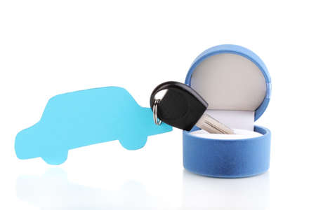Car key with charm in box isolated on white photo