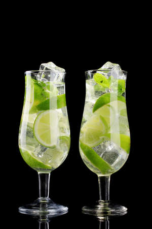 cool mint: glasses of cocktails with lime and mint on black background