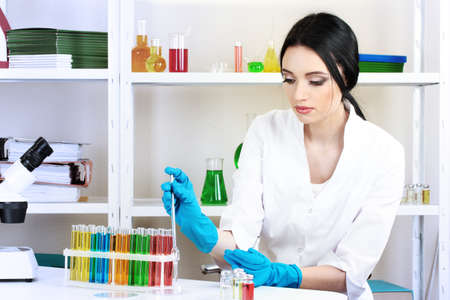 Young female scientist working in chemical laboratory photo