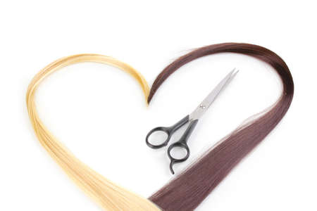 hairdressing scissors: Shiny blond and brown hair with hair cutting shears isolated on white Stock Photo