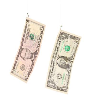 Dollars on fishing hooks isolated on white photo