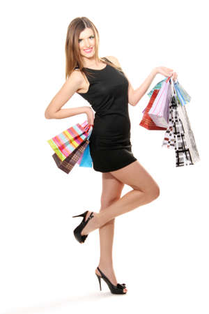 beautiful young woman with shopping bags isolated on white Stock Photo - 12566463