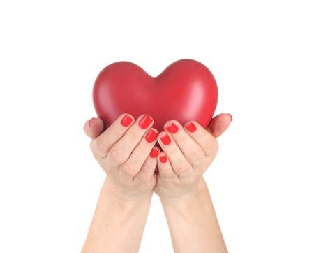 bondad: Corazón rojo en manos de la mujer aislada en blanco Foto de archivo