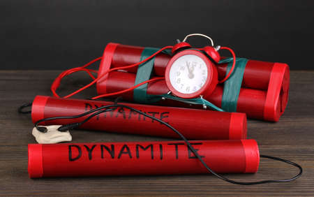 Timebomb made of dynamite on wooden table on grey background Stock Photo - 12649481