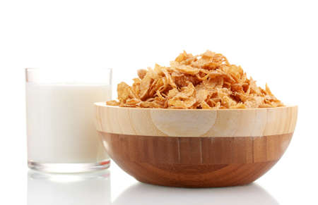 tasty cornflakes in wooden bowl and glass of milk isolated on white photo
