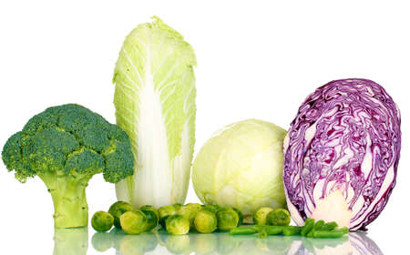 Fresh cabbages and broccoli isolated on white photo