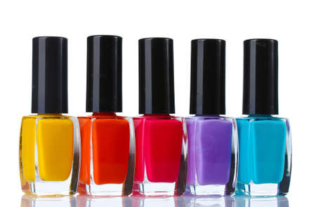 Group of bright nail polishes isolated on white photo