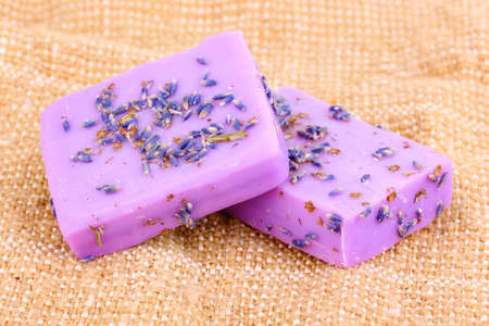 Hand-made lavender soaps on sackcloth photo