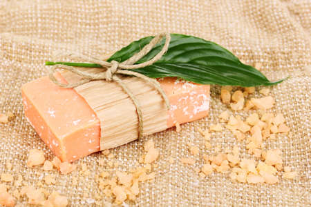 Hand-made natural soap on sackcloth photo
