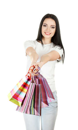 beautiful young girl holding bright bags isolated on white Stock Photo - 13050288