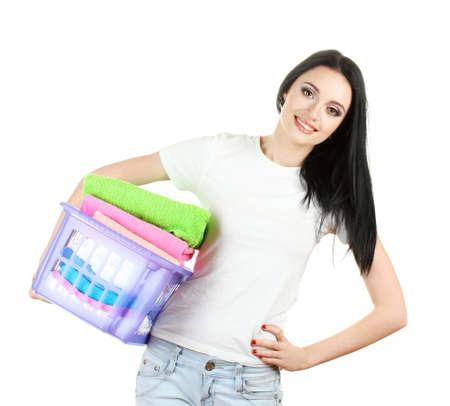 beautiful young girl holding basket of laundry isolated on white photo