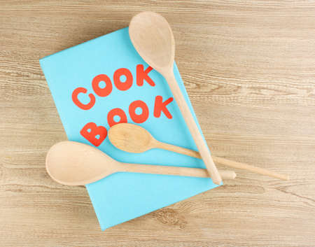 Cookbook and kitchenware on wooden background Stock Photo - 12717655