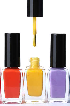Group of bright nail polishes isolated on white Stock Photo - 12718060
