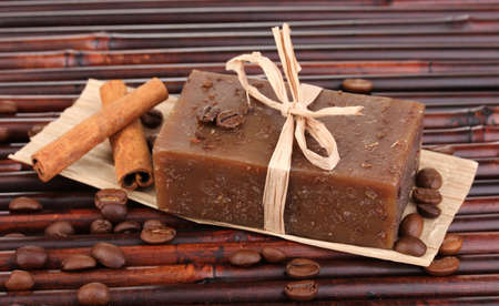 Hand-made soap on bamboo mat photo