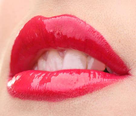 beautiful make up of glamour red gloss lips photo