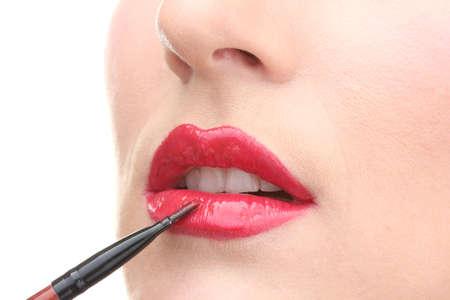 gloss: beautiful woman applying lip gloss