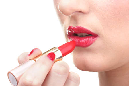 beautiful woman is applying her lips with red lipstick Stock Photo - 12717778