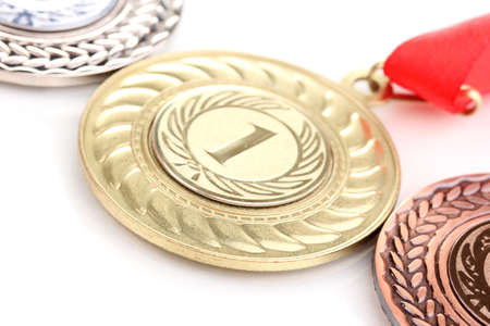Three medals close-up isolated on white photo