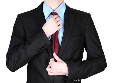 businessman correcting a tie close up photo