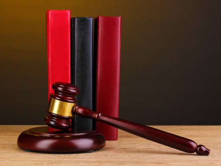 Judge's gavel and books on wooden table on brown background Stock Photo - 12715774
