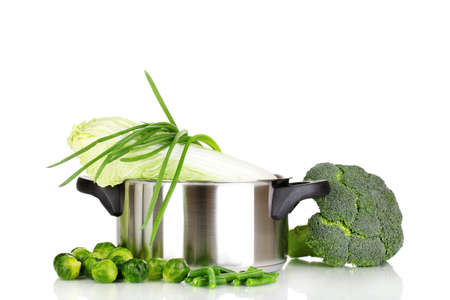 Saucepan with cabbages, broccoli and onion isolated on white photo