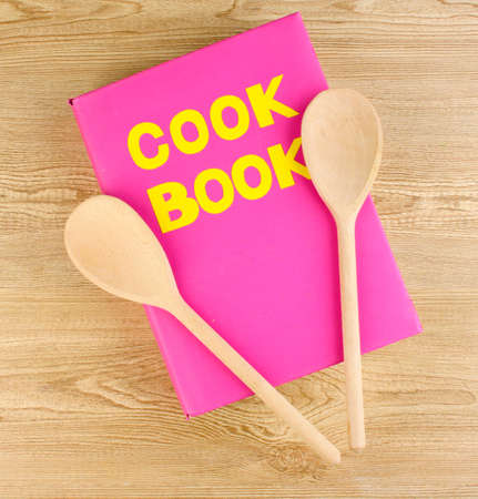 recipe book: Cookbook and kitchenware on wooden background