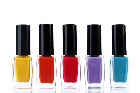 Group of bright nail polishes isolated on white Imagens