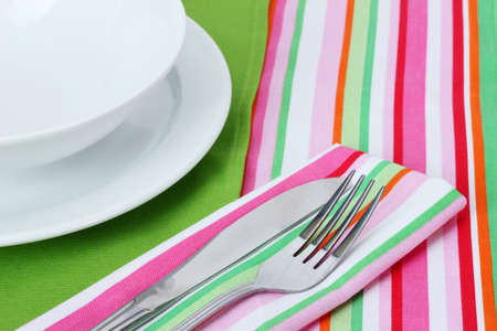 Table setting with fork, knife, plates, and napkin Stock Photo - 12715757