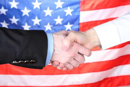 Business handshake on american flag background photo