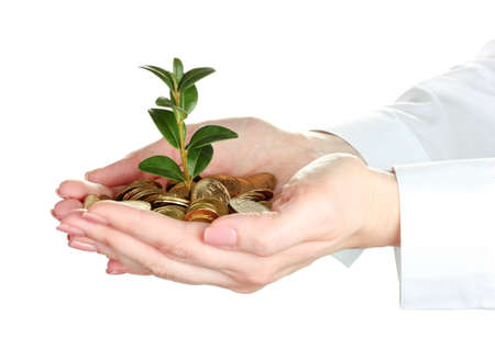 grow money: Woman hands with coins and plant isolated on white