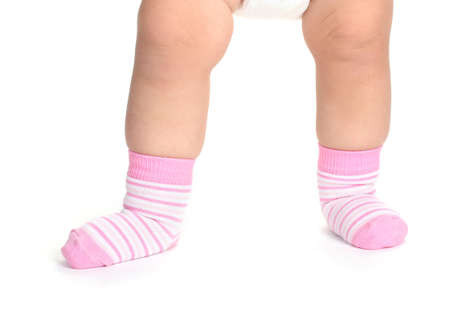 kids feet: Baby feet fin socks isolated on white