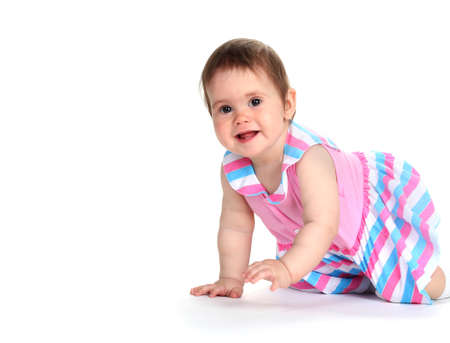 Cute baby girl crawling isolated on white photo