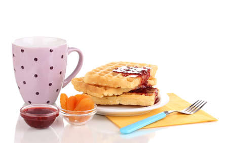 Tasty waffles with jam on plate isolated on white photo